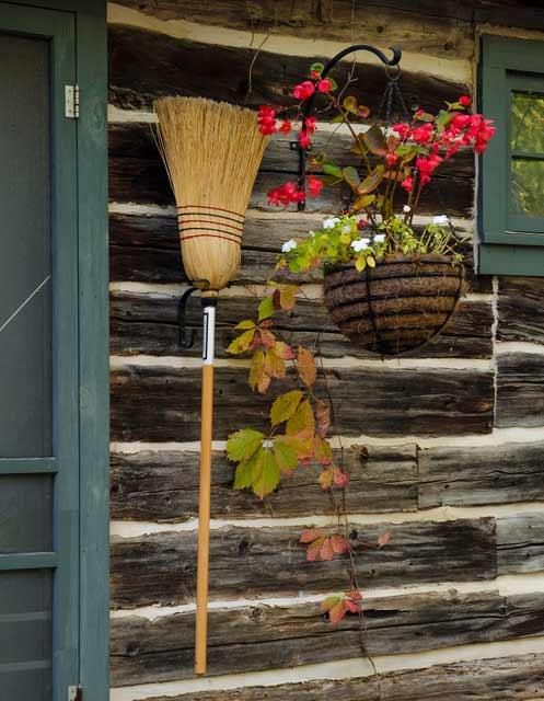 Broom hanging by the door